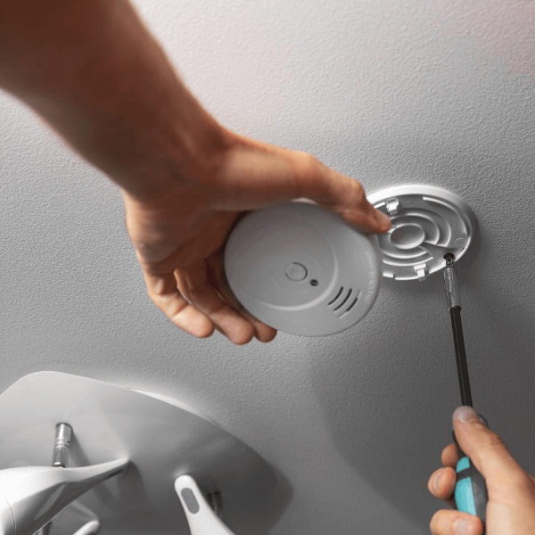 Electrician Installing Alarm