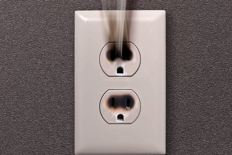 Emergency Electrical problem with an outlet smoking