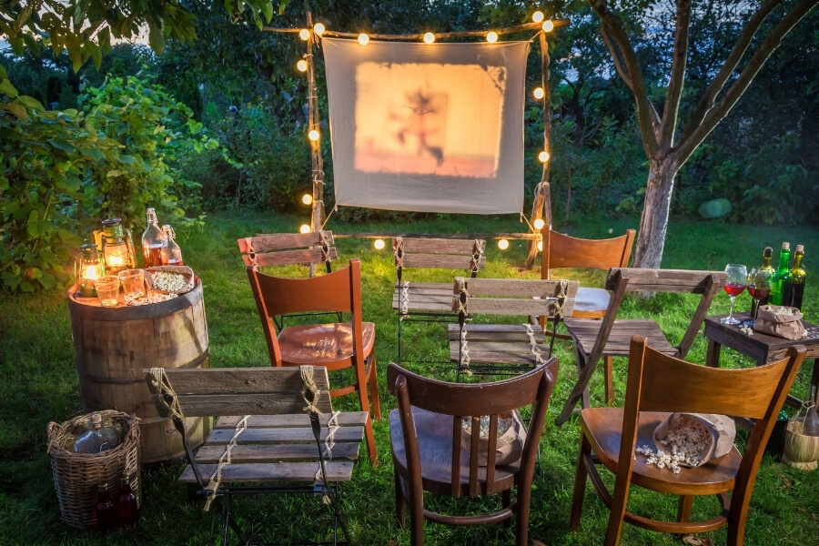 Outdoor movie screen with sparkly lights and chairs