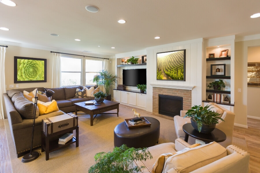 Living room with custom ambient lighting in built-ins and recessed lighting